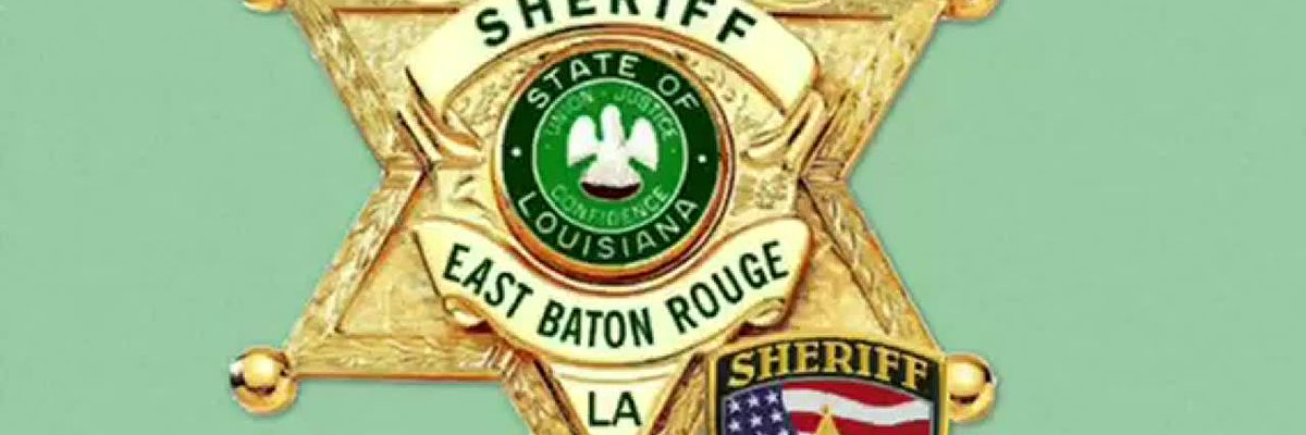 EBRSO reserve deputy radios for help to rescue man trapped in submerged vehicle