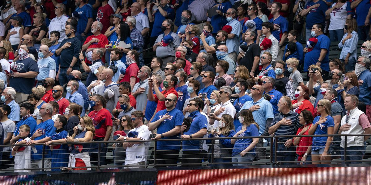 Rangers fill stands with fans, who accept 'calculated risk'