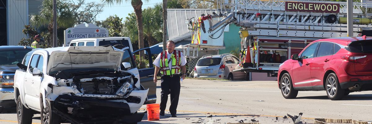 Car collides with building after 4 vehicle crash