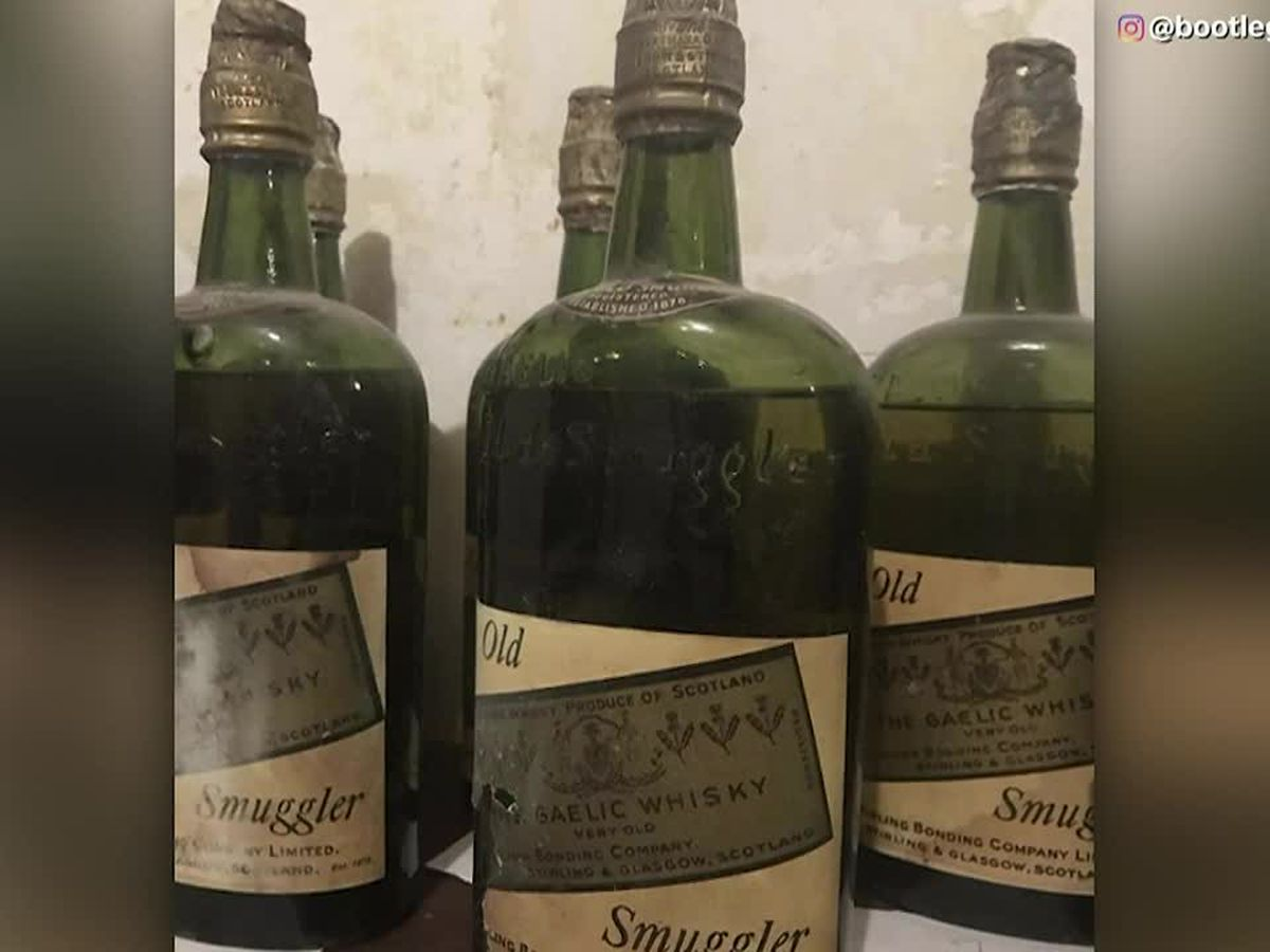 Couple finds walls of whisky in new home