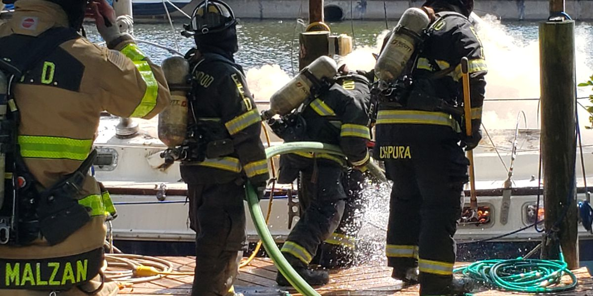 Firefighters respond to sailboat fire in canal in Englewood