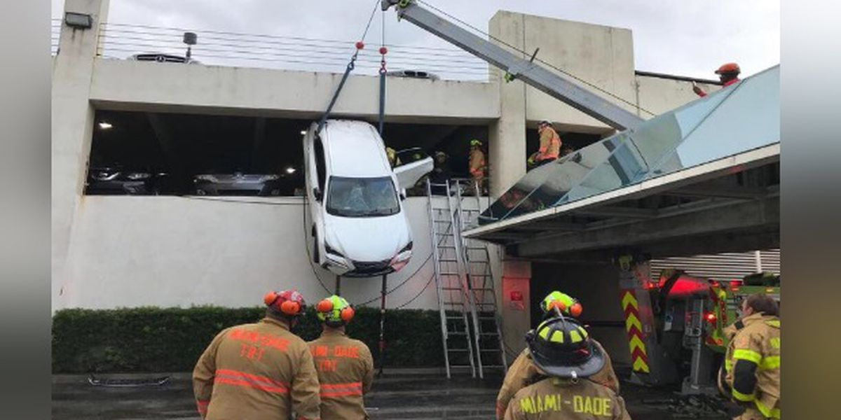Woman rescued as car dangles from parking garage near Miami
