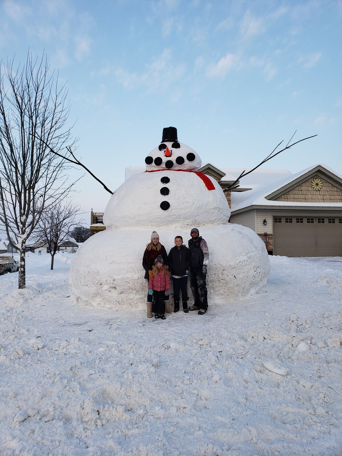 massive minnesota snowman towers over neighborhood