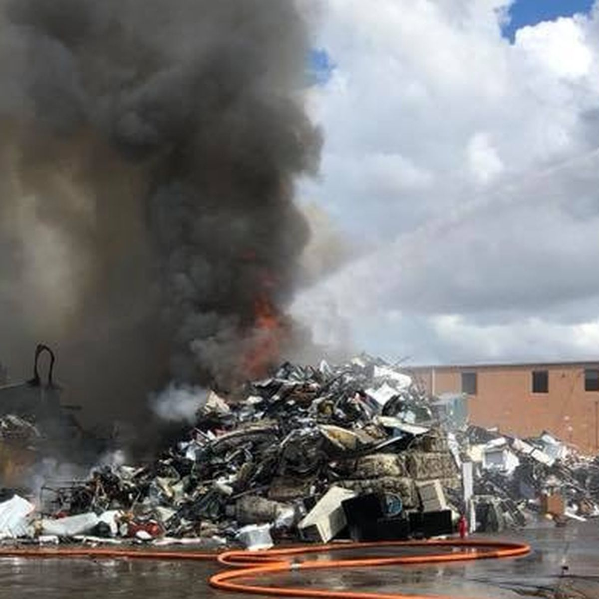 Two-alarm fire at metal and recycling plant sends large plume of smoke over Sarasota