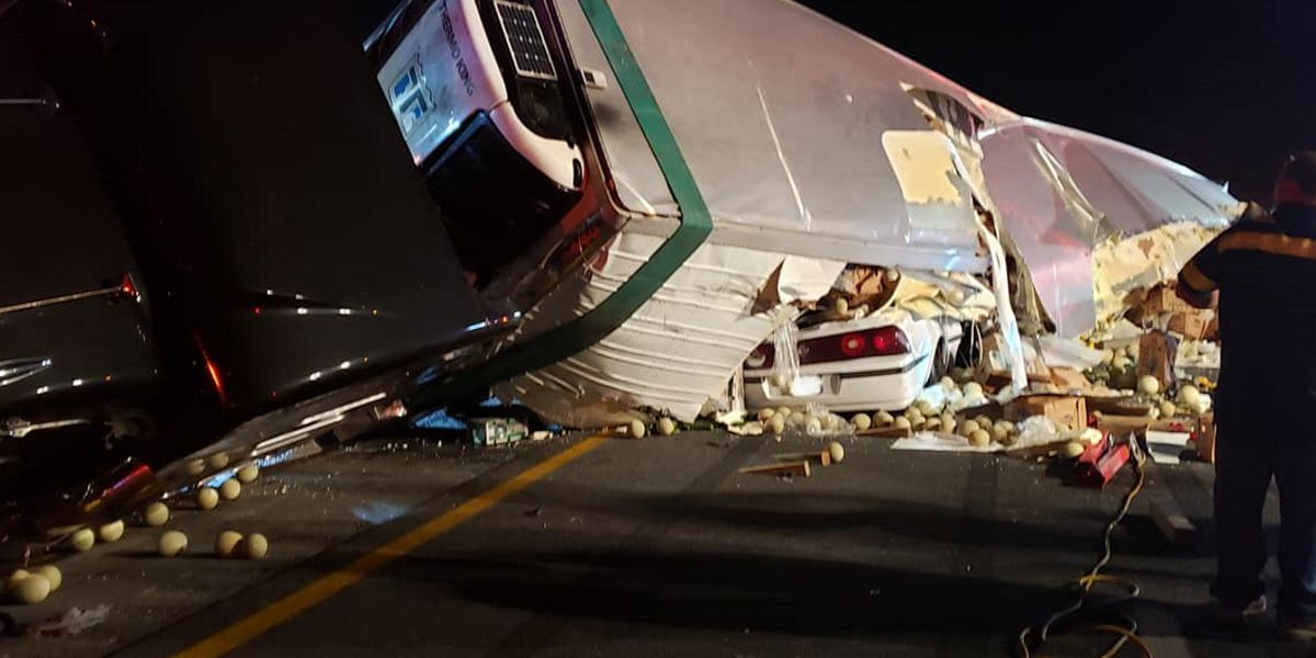 Semi trailer falls on top of car on I-75, trapping the driver and passenger inside