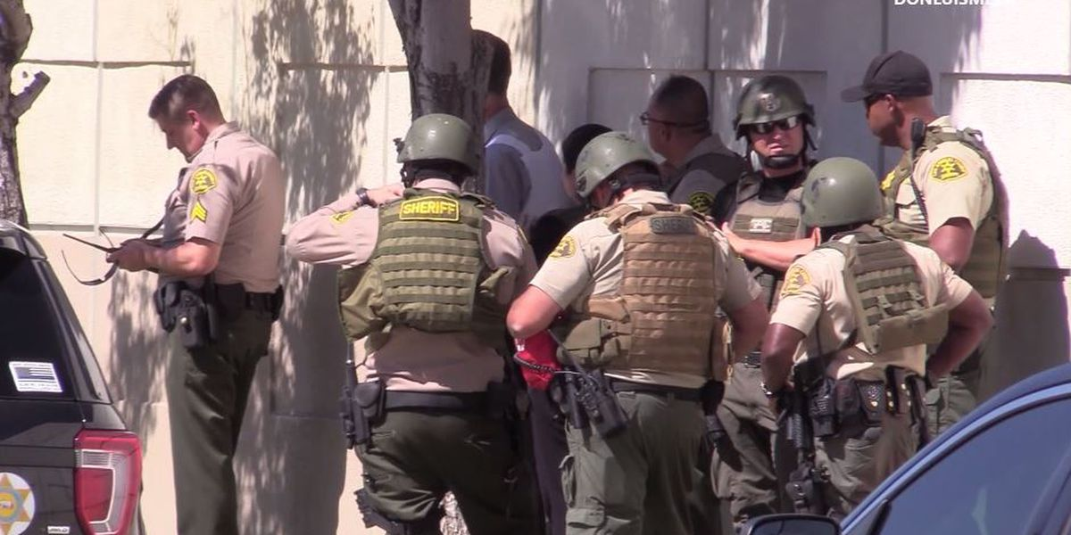 Gunman at large after Los Angeles deputy shot at sheriff's station