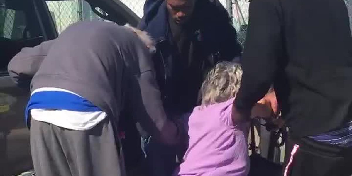 Fl: Three young men help 89-year-old woman get into car, officer records video