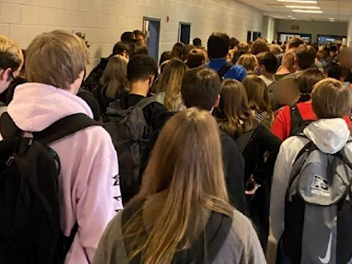 Georgia school with large crowds reports positive virus cases, closes for cleaning