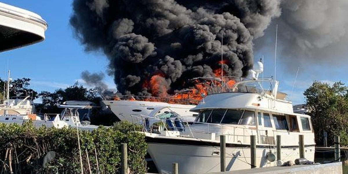 Crews work to extinguish fire onboard boat docked in Cortez Cove