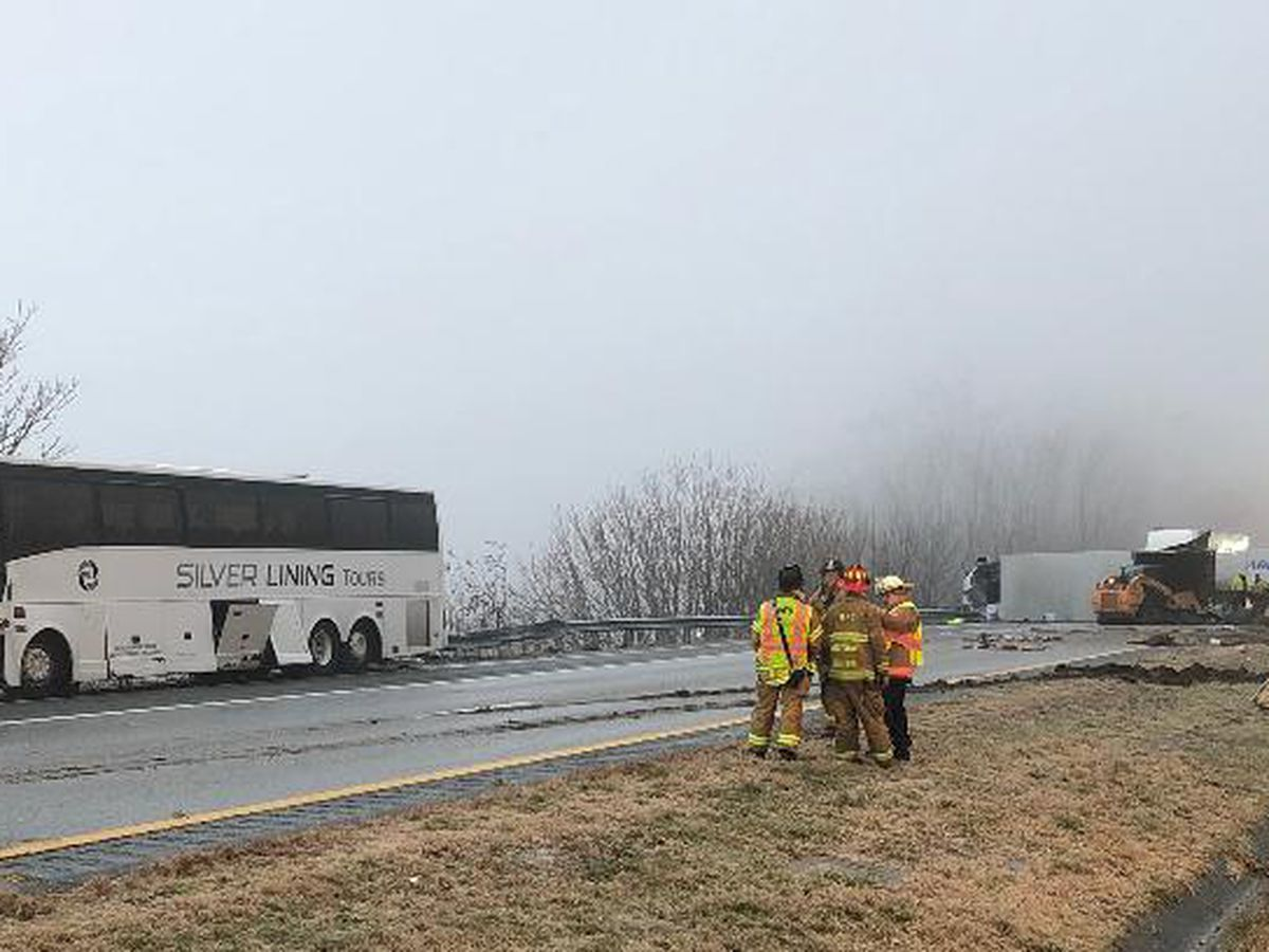 29 sent to hospital after tour bus crashes into tractor-trailer, splitting truck in half