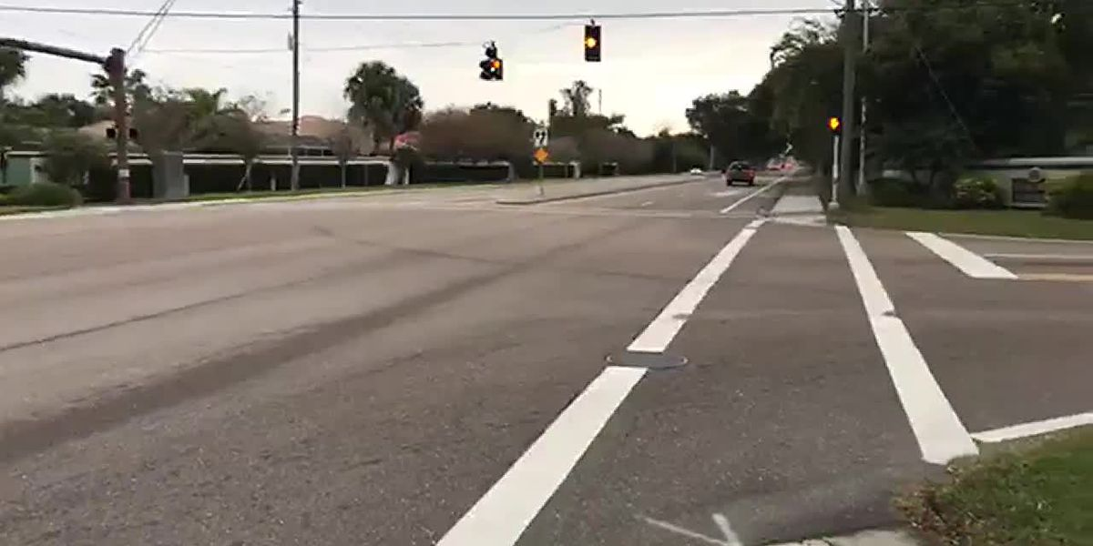 15-year-old boy hit by car while crossing street to get on school bus