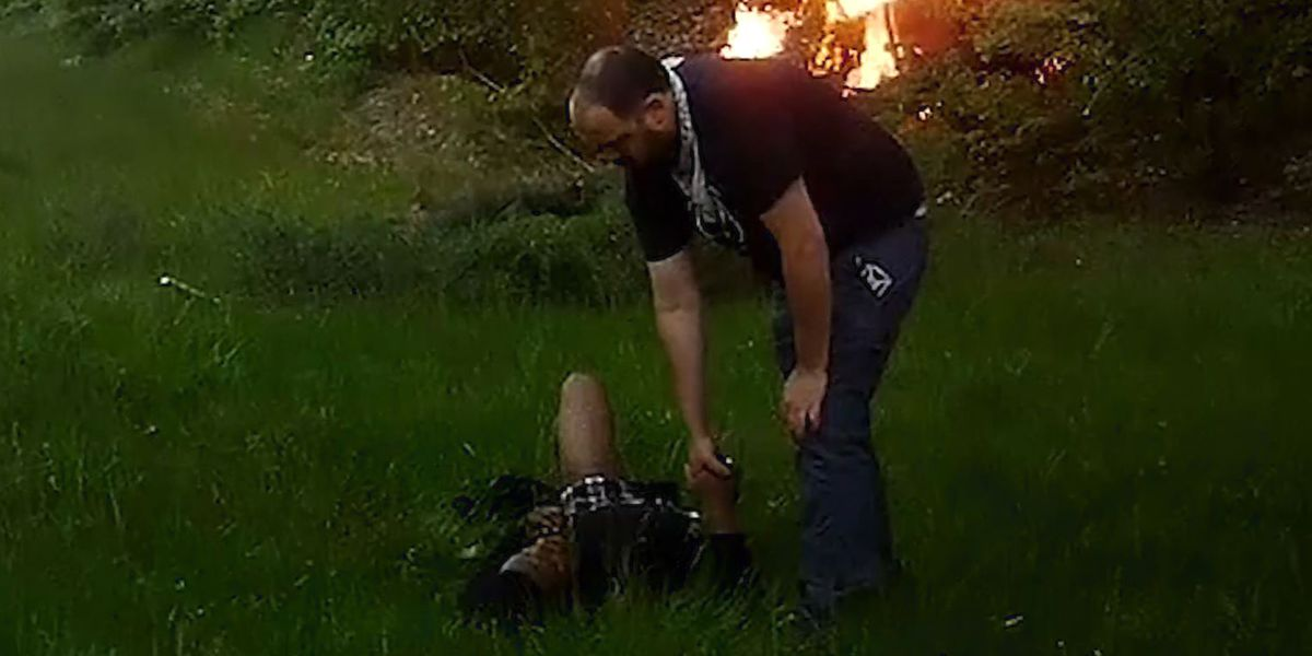 Good Samaritan rescues man from burning car, holds his hand as ambulance arrives