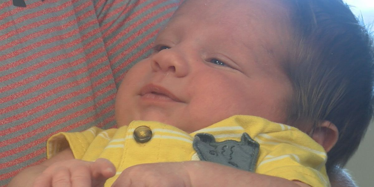 After parking lot birth, local family reunites with emergency responders