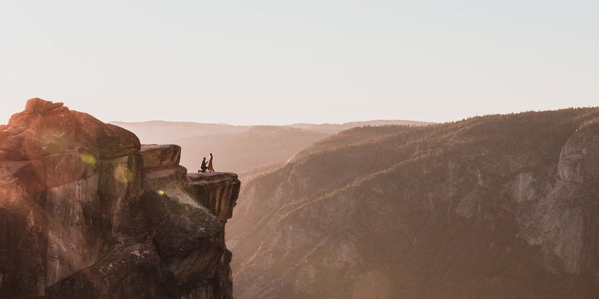 Photographer looks for couple in proposal picture