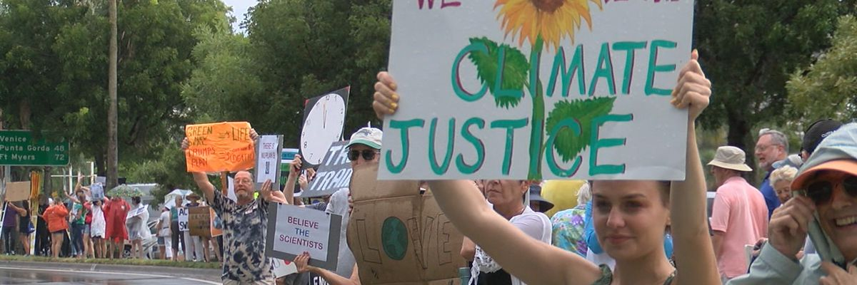 Large group of protestors in Sarasota pushing for improvements to the climate