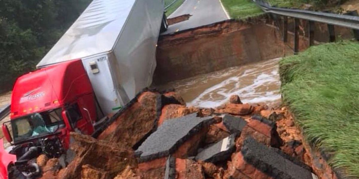 Tractor trailer driving over SC highway as it collapses