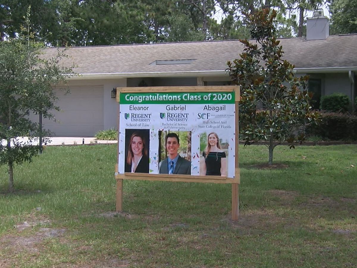 North Sarasota family with three graduates honors them with banner in the front yard of their home