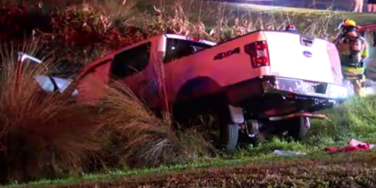 Crash sends two vehicles into pond off University Parkway