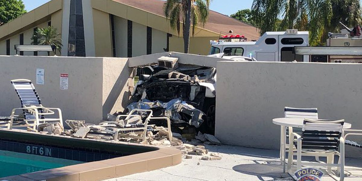 Two car collision results in one vehicle crashing into motel
